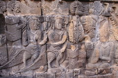 Bass-relief on the wall in Borobudur temple Royalty Free Stock Photo