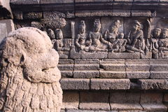 Bass-relief on the wall in Borobudur temple. Bass-relief on the wall in Borobudur Buddhist temple, Indonesia, Java Royalty Free Stock Images