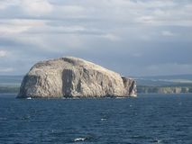 Bass Rock in the sun. Bass Rock, for the coast of England, in the full sun, as seen from the boat royalty free stock photos