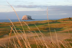 Bass Rock at sunset over The Glen golf course Stock Photo