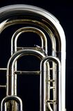 Bass Tuba Euphonium. A brass gold bass tuba euphonium against a black background in the vertical format with copy space Stock Image