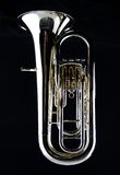 Bass Tuba Euphonium. A complete brass gold bass tuba euphonium against a black background in the vertical format with copy space Royalty Free Stock Photography