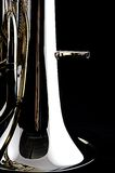 Bass Tuba Euphonium. A brass gold bass tuba euphonium against a black background in the vertical format with copy space Stock Photos