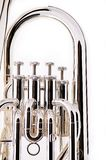 Bass Tuba Euphonium. A silver bass tuba euphonium against a white background in the vertical format with copy space Royalty Free Stock Photography