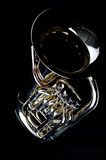 Bass Tuba Euphonium. A complete brass gold bass tuba euphonium against a black background in the vertical format with copy space Royalty Free Stock Photo