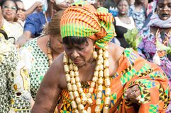 Exhibition of valuable goods by women. Bassam, Côte d`Ivoire - November 7, 2015: old women dressed in traditional pagnes of values, golden fastenings in royalty free stock image
