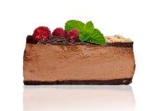 Basse tranche de gâteau au fromage de chocolat de carburateur Photographie stock