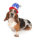 Basset Hound Dog Wearing Independence Day Hat. Basset Hound dog wearing a 4th of July hat. Isolated on white royalty free stock image