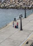 Travelers on Pier stock photography
