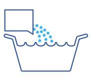 Bassin de blanchisserie avec le détergent   Image stock