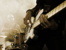 Bassist in the foreground. royalty free stock photography