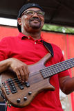 Bassist of Geno Delafosse & French Rockin Boogie. BREAUX BRIDGE, LOUISIANA, May 2, 2015 : Geno Delafosse & French Rockin' Boogie plays during Crawfish Festival Royalty Free Stock Photo