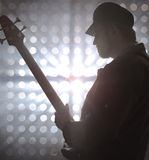 Bassist playing bass guitar in smoke Royalty Free Stock Photo