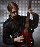 Bassist playing a custom made  bass guitar Royalty Free Stock Photo