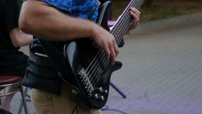 Bassist playing electric bass guitar, effect picture.  stock video