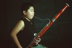 Мальчик bassoon Стоковые Изображения