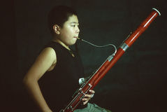 A bassoon boy stock images
