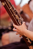 Bassoon in the hands of a musician Royalty Free Stock Photography