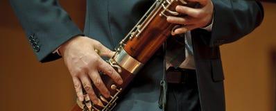 Bassoonist en música de compartimiento Imagenes de archivo