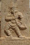 Bassorilievi di pietra sulle pareti il tempio di Achyuta Rayas circa la via del ` s della cortigiana - Sule Bazaar in Hampi, il K immagine stock libera da diritti