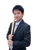 Bastão de beisebol asiático da terra arrendada do homem de negócio Fotografia de Stock Royalty Free