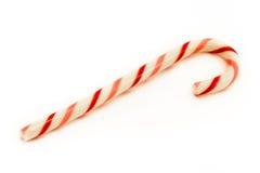 Bastão de cana listrado vermelho e cor-de-rosa sobre o branco Fotografia de Stock
