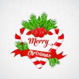 Bastão de doces do Natal com azevinho e a fita vermelha Fotos de Stock Royalty Free