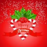 Bastão de doces do Natal com azevinho e a fita vermelha Fotografia de Stock Royalty Free