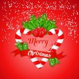 Bastão de doces do Natal com azevinho e a fita vermelha Fotos de Stock