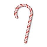 Bastão de doces do Natal com a curva vermelha isolada no fundo branco Fotos de Stock