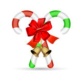 Bastón de caramelo de la Navidad con el arco rojo Fotos de archivo libres de regalías