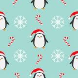 Bastón de caramelo del copo de nieve de la Navidad, pingüino que lleva el sombrero rojo de santa, bufanda Decoración inconsútil d Imagen de archivo libre de regalías