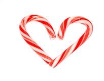 Bastón de caramelo del corazón Fotos de archivo libres de regalías