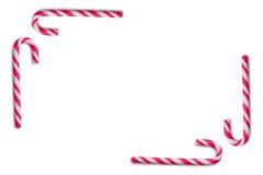 Bastón de caramelo en el fondo blanco foto de archivo libre de regalías