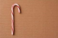 Bastón de caramelo en la cartulina Imagen de archivo