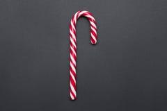 Bastón de caramelo rayado Foto de archivo
