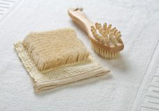 Bast and massager on cotton towel Stock Photo