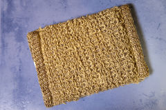 Bast from natural fiber on a tile, flat lay Royalty Free Stock Image