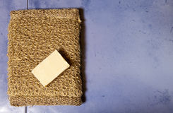 Bast from nettle fiber and a piece of soap, flat lay Stock Photos