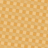 Bast seamless background. Seamless bast texture background of pale yellow pattern square tiles Royalty Free Stock Photo