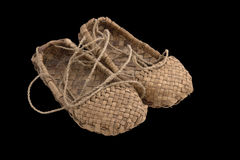 Bast shoe (sandals) of Russian poor villager. Royalty Free Stock Photos