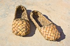 Bast Shoes. Ancient Russian national footwear of peasants weaved from a bark of trees Stock Photography