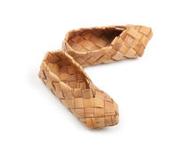 Bast shoes,. Bast, ancient russian shoes,  on white Royalty Free Stock Photos
