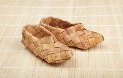 Bast shoes. Bast, ancient russian shoes on wooden floor Royalty Free Stock Images
