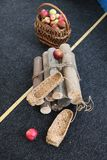 bast shoes, apples, basket, firewood stock photo