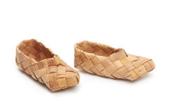 Bast shoes, isolated. Bast, ancient russian shoes, isolated on white Stock Images
