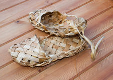 Bast shoes. Russian bast shoes standing on the wooden floor Stock Photo