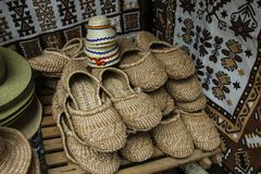 Bast shoes, woven from bast, ethno home shoes. stock image