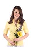 Bastante adolescente con las flores Fotos de archivo libres de regalías