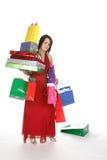 Bastante adolescente con los bolsos de compras Foto de archivo libre de regalías